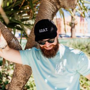 Cayle in a GOAT Cap
